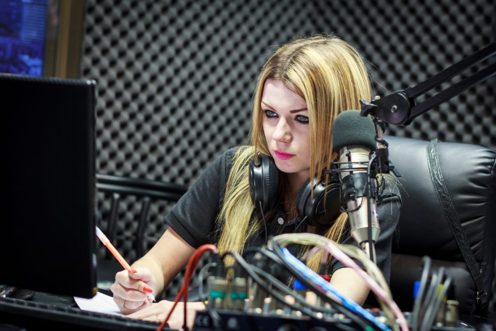 Woman Working As Radio DJ Live In Studio