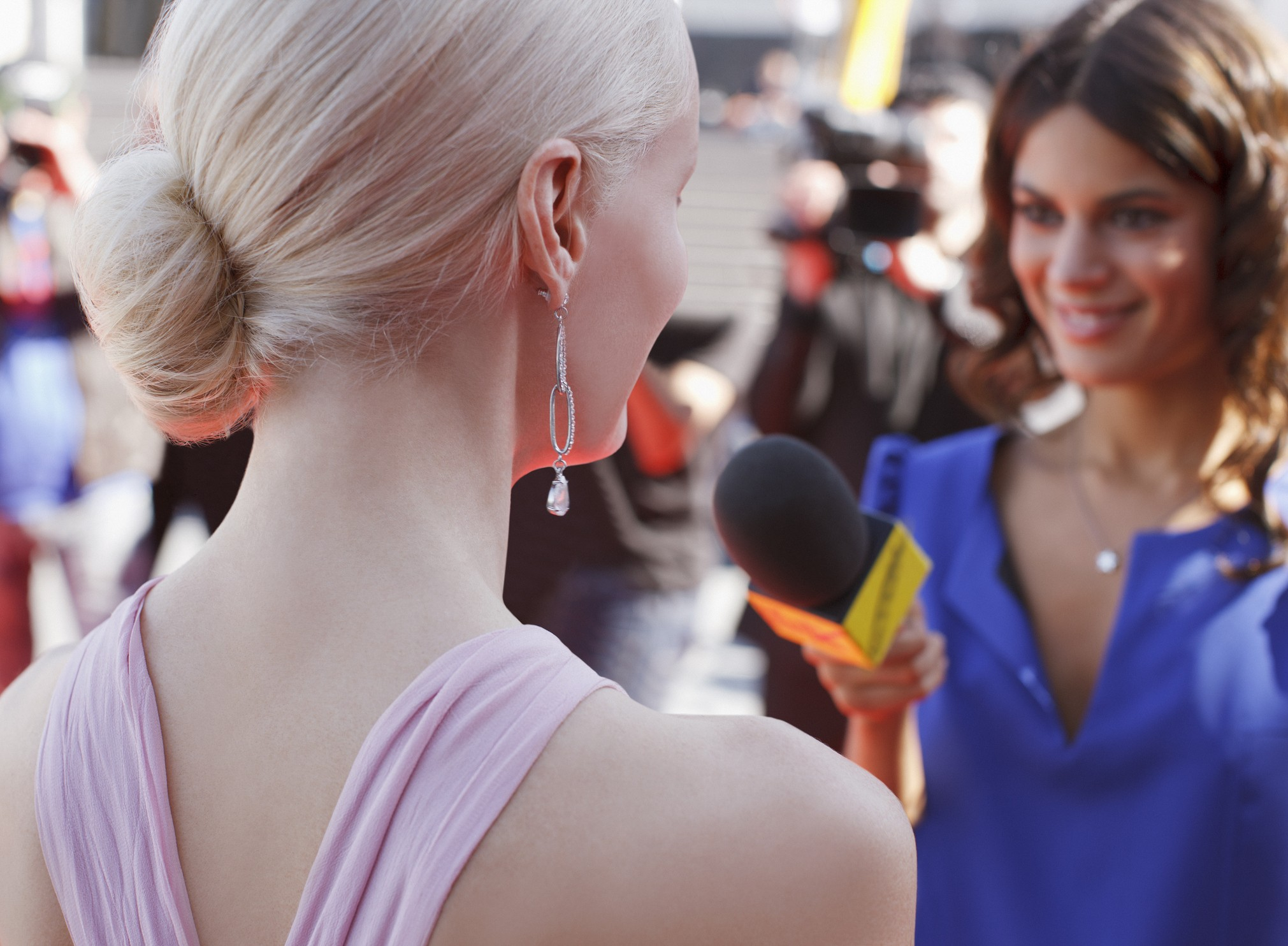 Celebrity speaking to reporter on red carpet