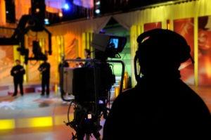 Cameraman works in the studio - recording show in TV studio