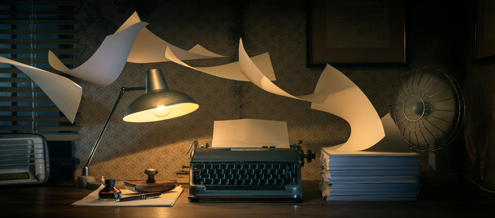Vintage,Writer's,Desktop,With,Typewriter,And,Flying,Sheets,,Creativity,And