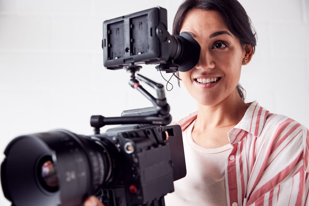 Woman operating a film camera